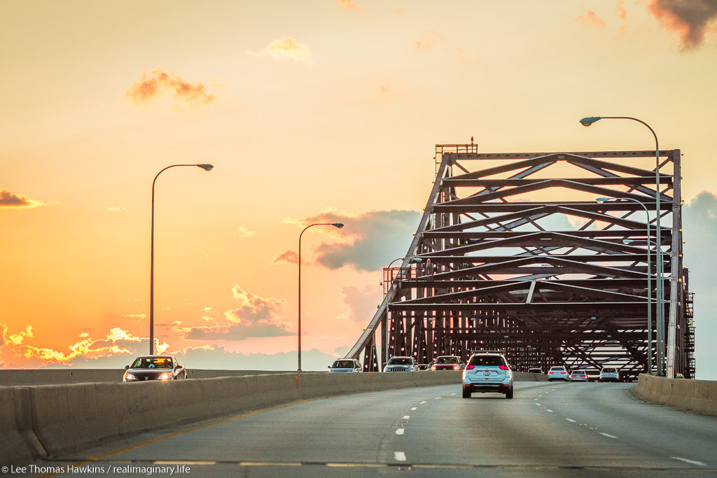 Cars make their way across the High Bridge on the Chicago Skyway at sunset.