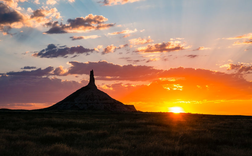 The sun sets over Chimney Rock on a summer evening in Western Nebraska.
