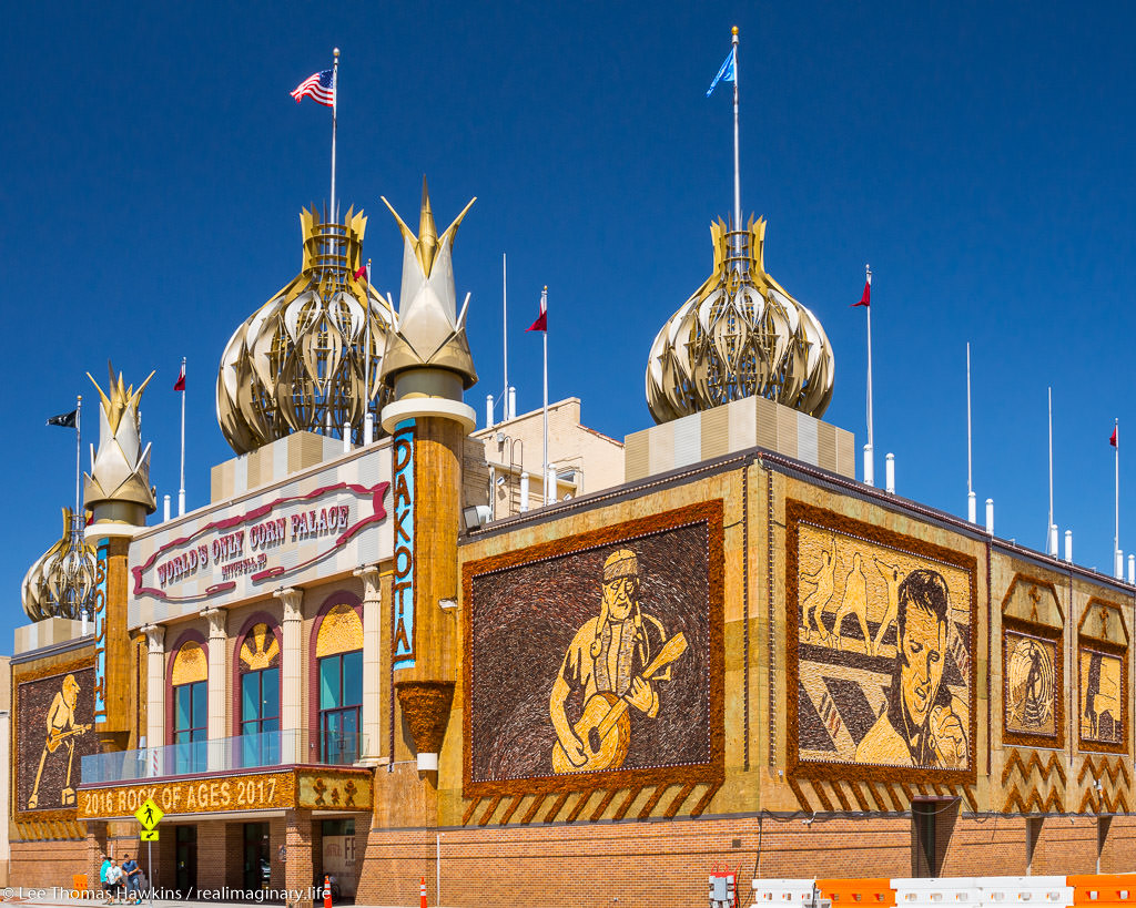 "The Corn Palace in Mitchell, South Dakota decorated in crop art for 2016-2017 with the ""Rock of Ages"" theme, featuring the likenesses of recording artists Willie Nelson and Elvis Presley"