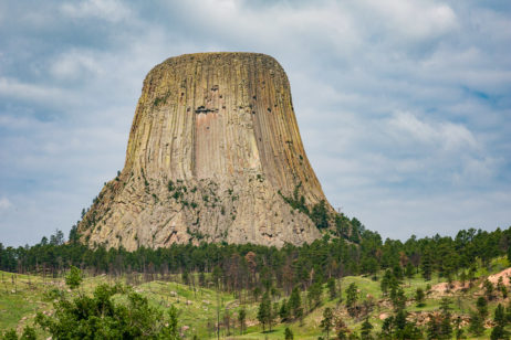 Reaching 867 feet from base to summit, Devils Tower pops out like a giant tree stump in the Northern Black Hills in Eastern Wyoming.