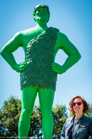 Becky poses with the Jolly Green Giant at Green Giant Statue Park in Blue Earth, Minnesota.