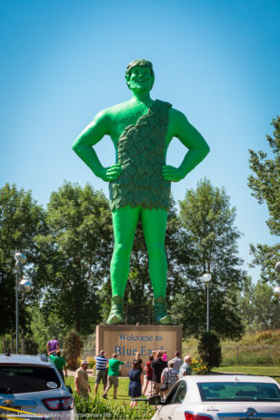 People gather at Green Giant Statue Park in Blue Earth, Minnesota to photograph a 60-foot tall statue of the Jolly Green Giant.
