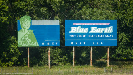 A billboard along I-90 near Blue Earth, Minnesota encourages tourists to stop and visit their 60' Jolly Green Giant.