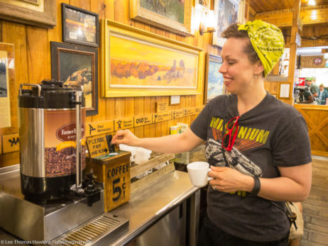 Becky drops a nickel into the box for a cup of coffee at the Wall Drug Store in Wall, South Dakota.